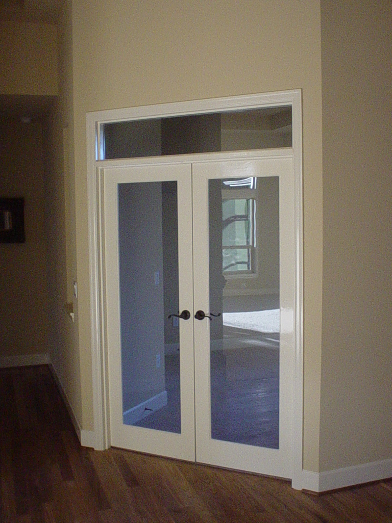 Painted French doors with transom